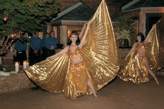 anisa-dance-group-wearing-cleopatra-wigs-and-gold-bras