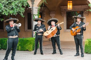 wedding-reception-mariachi-band-four-person-band-guitars-sombreros-and-trumpet-at-outdoor-wedding