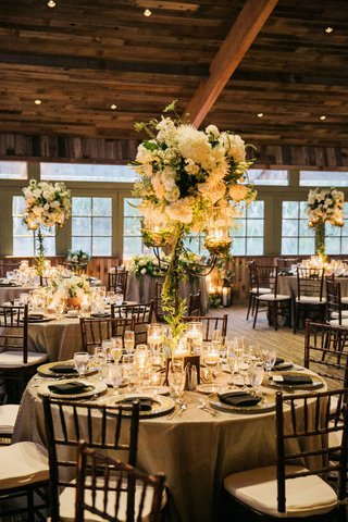 rod-iron-candelabra-centerpieces-hydrangea-roses-lisianthus-veronica-dahlias-queen-annes-lace