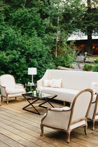 sundance-wedding-reception-on-wood-porch-with-lounge-furniture-trees
