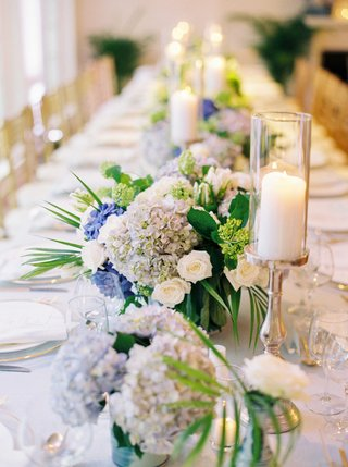 head-table-with-candles-and-low-small-centerpieces-white-rose-blue-hydrangea-greenery