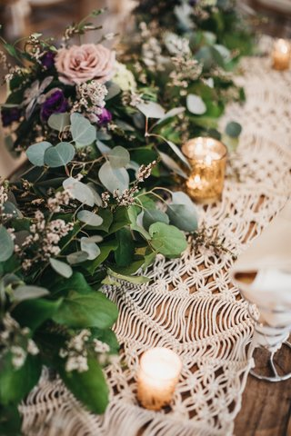 macrame-runner-topped-with-gold-mercury-votives-and-garland-with-eucalyptus
