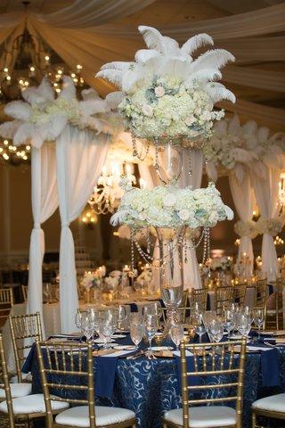 round-table-navy-linen-pattern-feather-arrangement-north-carolina-wedding-flowers-crystals-gold