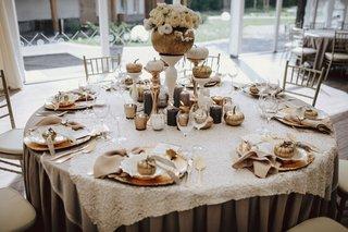 wedding-reception-table-round-pumpkin-centerpiece-with-flowers-pumpkin-place-settings-escort-cards
