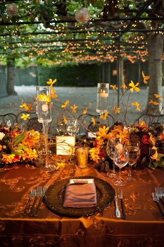metallic-tablecloths-and-floating-candle-centerpieces