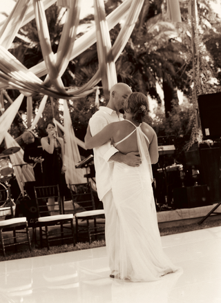 sepia-tone-picture-of-bride-and-grooms-first-dance