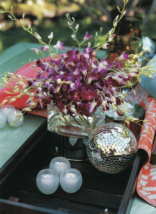 daybed-with-black-tray-orchid-arrangement-and-disco-ball