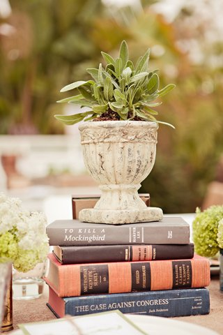 vintage-books-hold-vessel-of-sage