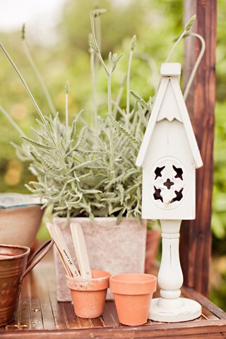 clay-pots-and-white-bird-house