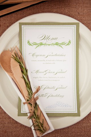 menu-on-plate-with-silverware-and-rosemary