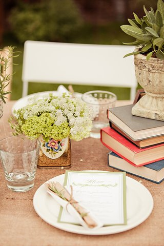tablescape-with-stack-of-books-and-flowers