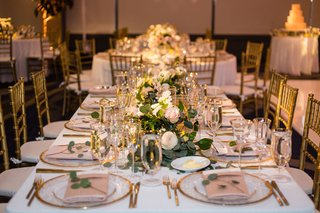 wedding-reception-long-table-low-centerpiece-gold-charger-eucalyptus-pink-white-rose-candles