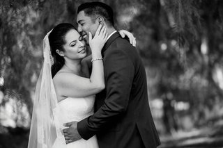 black-and-white-photo-of-bride-and-groom-with-arms-around-each-other