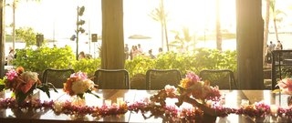 hawaiian-lei-candles-and-tropical-flower-centerpiece