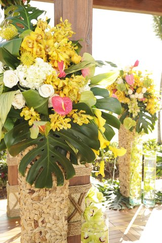 jungle-leaves-and-flowers-in-tall-baskets