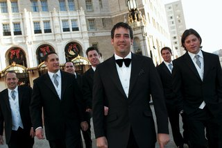 groom-with-groomsmen-in-black-tuxedos-and-striped-ties