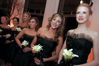bridesmaids-in-black-party-dresses-with-calla-lily-bouquets
