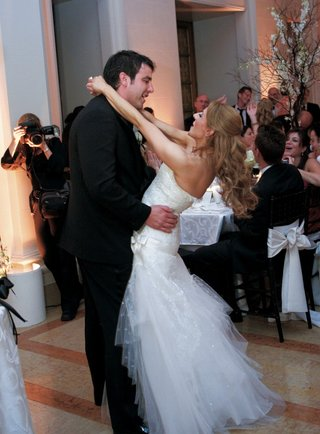 bride-swings-around-groom-during-reception-first-dance