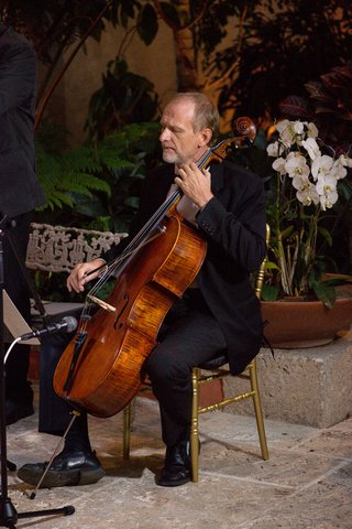 cellist-performing-at-nighttime-wedding-ceremony