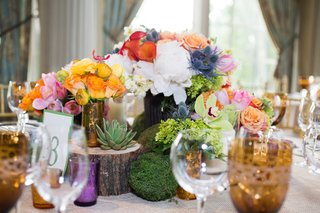 colorful-rustic-flowers-and-wood-decor-on-table-for-gay-wedding-centerpiece