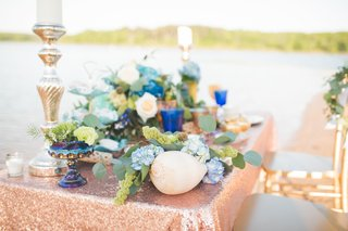 sequin-tablescape-with-shells-candlesticks-floral-arrangements