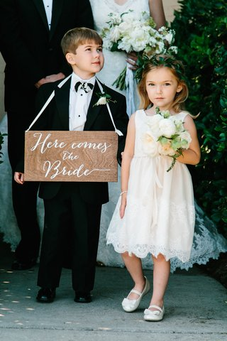flower-girl-in-lace-flower-girl-dress-with-flower-crown-ring-bearer-wood-sign