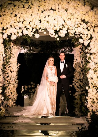 wedding ceremony portrait white flower chuppah decor rose hydrangea flowers geller events