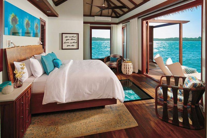 Bedroom at Sandals Resorts Bungalow