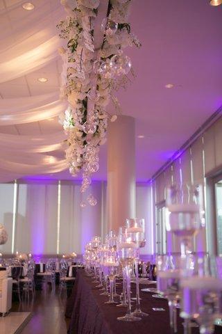 brendan haywood nba player wedding reception purple lighting candles white flowers drapery