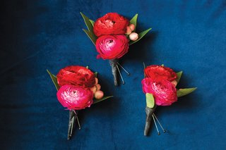 three-boutonnieres-made-with-two-dark-pink-ranunculuses