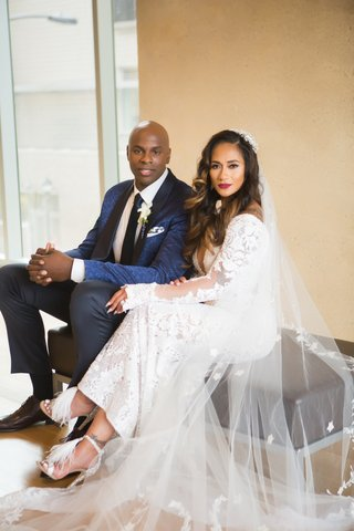bride in long sleeve sheer wedding dress jimmy choo heels with groom brendan haywood nba player navy