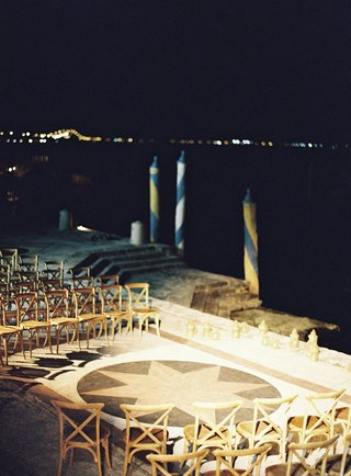 wedding-ceremony-on-tiled-flooring-at-villa-venue-in-miami-overlooking-water-venice-inspired