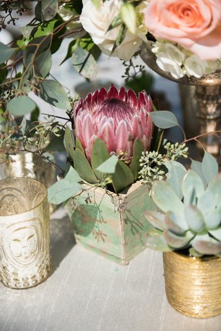 garden-wedding-reception-table-with-red-protea-leaves-in-wood-box-succulent-in-golden-vessel