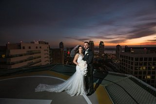 wedding photo on the rooftop of westin san diego sunset portrait bride and groom