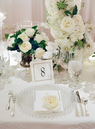 cut-crystal-charger-plate-at-wedding-white-table-linen-white-rose-hydrangea-flower-arrangement