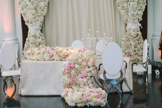 revelry-event-designers-chrome-white-modern-chairs-contrast-with-soft-floral-runner-pink-ivory