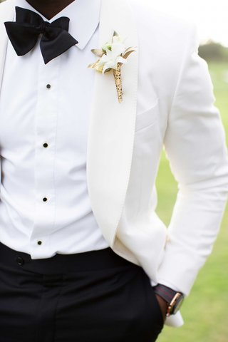 white-suit-jacket-boutonniere-with-gold-detailing-demarco-murray-wedding-attire