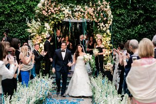 wedding ceremony at the four seasons los angeles at beverly hills confetti cannon recessional guests