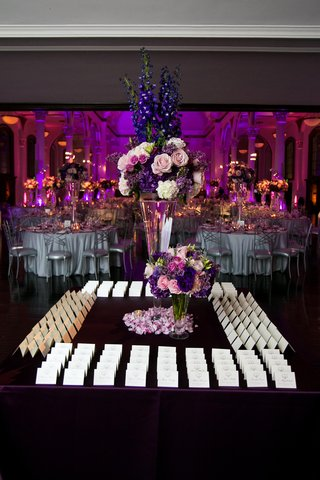 white-cards-on-square-table-with-tall-centerpiece
