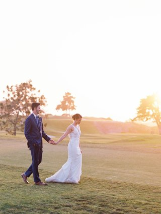 the-lodge-at-torrey-pines-wedding-portraits-on-golf-course-trees-sun-setting-walking-on-grass