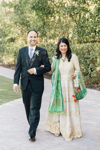 wedding-processional-mother-of-bride-in-hindu-traditional-attire-with-colorful-sash-escorted
