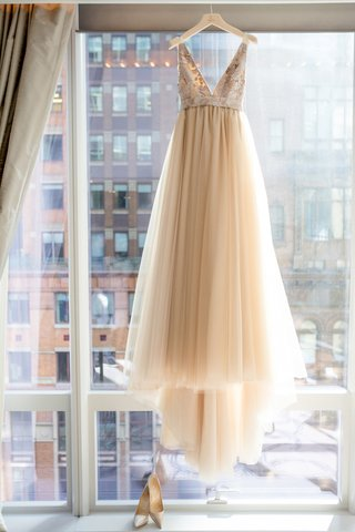 champagne-colored-bridal-gown-window-nyc-v-neck-unique-tulle-manolo-blahnik-heels-shoes