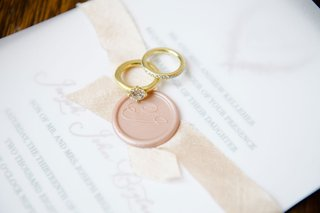 hammered-gold-engagement-ring-solitaire-and-wedding-band-invitation-pink-wax-seal