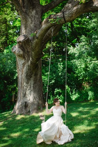 bride-on-swing-hanging-from-tree-at-crossed-keys-inn