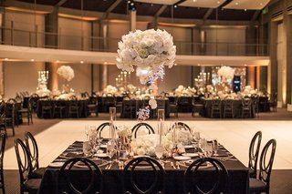 floating-centerpiece-with-orchids-roses-hydrangeas-flowers-encased-in-lucite