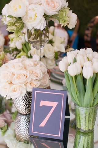 grey-and-pink-table-number-surrounded-by-rose-tulip-and-peony-flowers