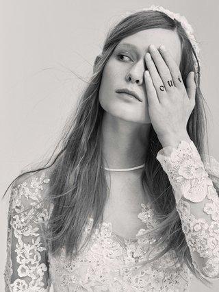 black-and-white-photo-of-elie-saab-bridal-spring-2017-long-sleeve-flower-applique-wedding-dress