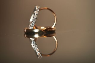 wedding-rings-detail-shot-gold-mens-room-with-eternity-band-diamonds
