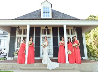 bride-in-ines-di-santo-dress-with-coral-bridesmaid-dresses
