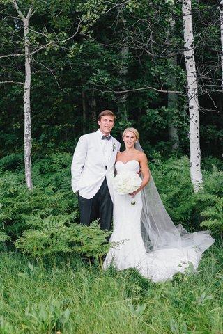 wedding-portrait-photo-bride-in-inbal-dror-strapless-wedding-dress-groom-in-white-tuxedo-jacket